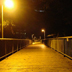 One of Kresge's pedestrian bridges at night